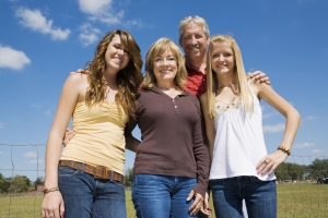 Grandparents and their beautiful teen granddaughters outside on the farm.